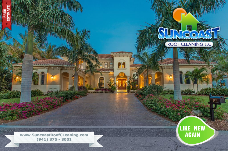 Suncoast Roof Cleaning in Sarasota performing a roof and house wash service