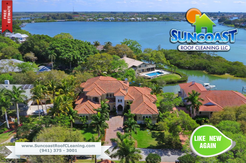 Suncoast Roof Cleaning in Sarasota cleaning a tile roof