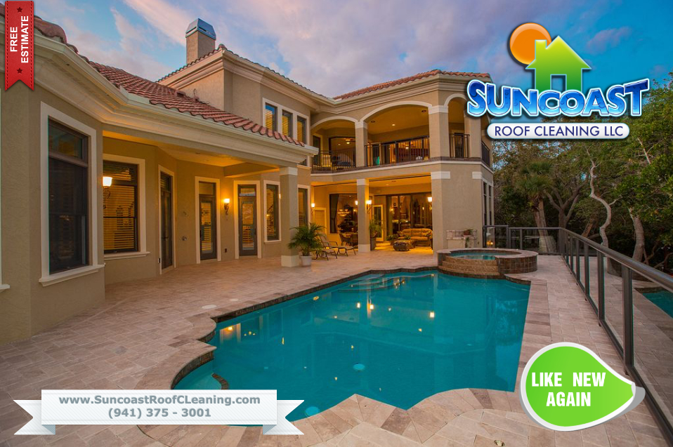 Suncoast Roof Cleaning in Sarasota performing a house wash services