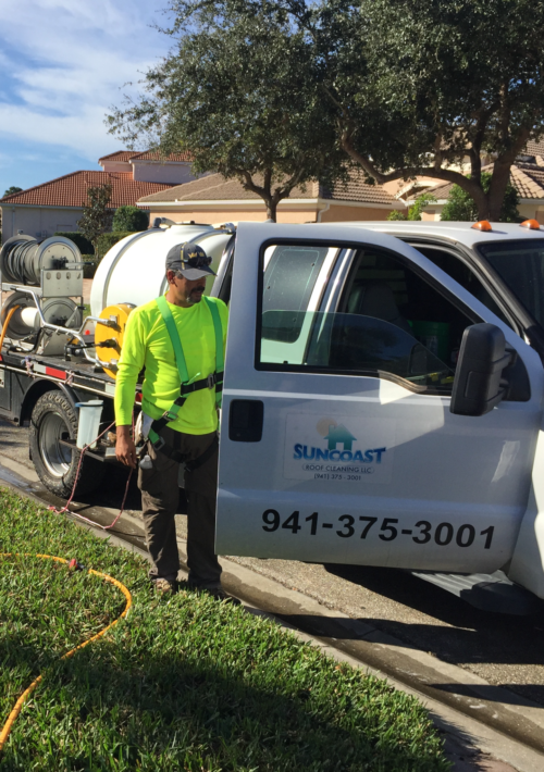 Suncoast Roof Cleaning in Sarasota getting ready to clean a roof